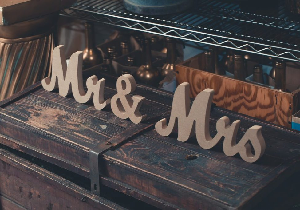 gray-mr-mrs-decors-on-brown-wooden-trunk-1858220